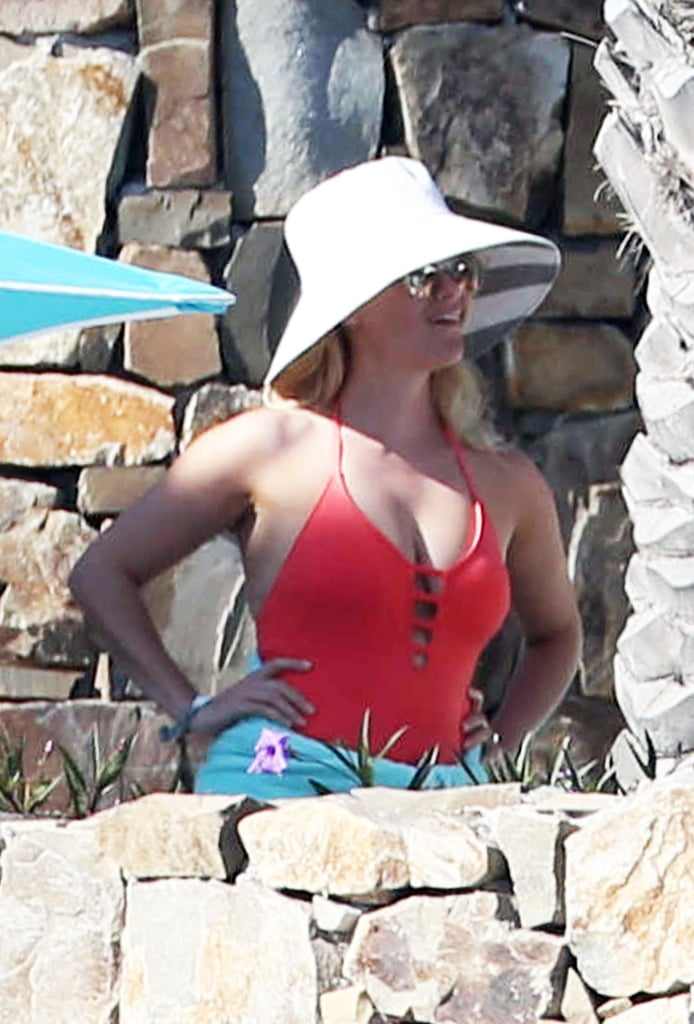 Reese played up her cutout monokini with a white sunhat.