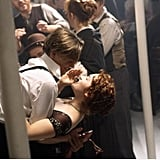 We think this is the moment Rose finally falls for Jack — though we fell for Leo long before. Rose's embellished evening gown looks gorgeous as she dances below deck.