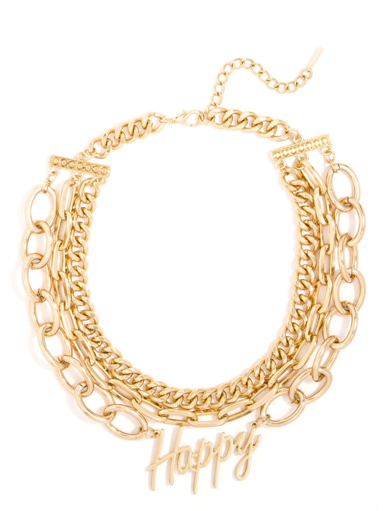 """What better way to declare """"Happy New Year"""" than with a gold multichain statement necklace that basically shouts the sentiment along with you? I don't even have my NYE dress picked out, but I know I'll be getting one to match BaubleBar's """"happy"""" text collar ($40). — KS"""