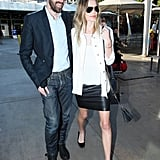 Kate Bosworth kept up her chic style game (per usual), this time in a slick leather skirt and Winter white topper.