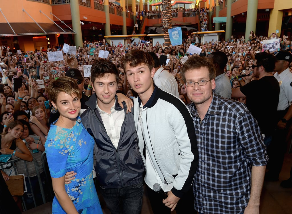 "Shailene Woodley, Ansel Elgort, John Green, and Nat Wolff greeted thousands of screaming fans who came out for the first stop on their The Fault in Our Stars tour on Tuesday in Miami. The crowds, who were well equipped with creative signs, came out for a glimpse of the cast and author, who debuted new footage from the film and hosted a Q&A. John kicked things off by introducing the exclusive 10 minutes of footage, but the real fun got started when Shailene, Ansel, and Nat joined him on stage. The foursome all talked about their favorite lines of the book and movie — with the iconic ""Okay? Okay."" getting a shout-out, of course — and revealed that the egging scene was among the most fun to film. John followed up the event with a Tumblr meet-up, where he graciously gave one-on-one time to as many fans as possible.  We're along for the whole fan tour, so follow POPSUGAR on Twitter and Instagram for exclusive behind-the-scenes looks at Shailene, Nat, Ansel, and John as they travel the country. Next up, the crew is headed to Cleveland, followed by Nashville and Dallas. All four cities were chosen by a fan vote, so they should expect more excited crowds, screaming girls, and fan enthusiasm as we gear up for The Fault in Our Stars to hit theaters June 6."
