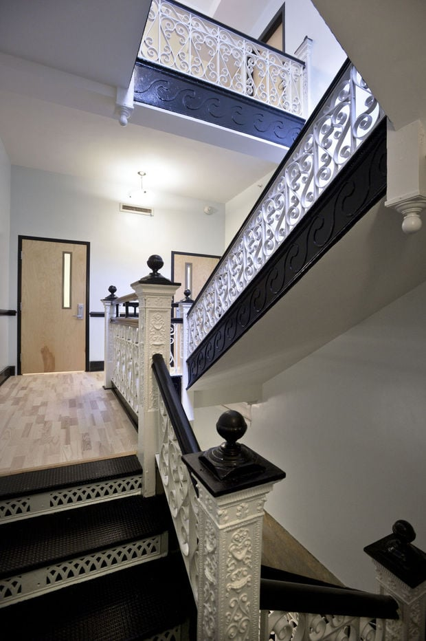 Preserving the original wrought-iron staircase was a perfect choice, merging classic and modern.