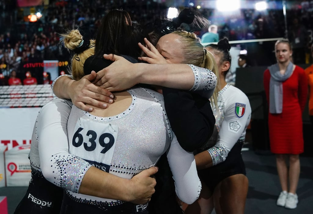 "On Oct. 8, the US women locked down gold at the team final of the 2019 World Gymnastics Championships. It was their fifth consecutive victory and their seventh overall. They finished with a 172.330, nearly six points above Russia, the second place team who totaled 166.529. But no one could deny that the most memorable celebrations from the event took place during the last rotation when the Italians realised they'd won bronze. Their third place finish marked the first time the women's team received a World medal in 69 years. The last time — and only time — the Italian women's team received a World team medal in gymnastics was in 1950, when they got bronze at the World Championships in Basel, Switzerland. The 2019 team consisted of Desiree Carofiglio, Alice D'Amato, Asia D'Amato (they're twins!), Elisa Iorio, and Giorgia Villa. And, for all of them but Desiree, it was their first World Championship appearance on the senior level. Italy had made it into the team final by getting eighth place in the qualifying round of Worlds — the top eight teams advanced through to the final. And, they also qualified for Tokyo 2020 with their performance (US, Russia, and China already qualified for the Olympics after finishing first, second, and third at 2018 Worlds; the top nine teams that didn't qualify last year, qualified this year). Giorgia, the 2018 Youth Olympic Games all-around gold medalist, told the Olympic Channel, ""It was really emotional making the top eight teams. We came into the competition with courage to do better than in qualifying."" She further explained to FIG that they didn't have any expectations going into the final, just to perform well. ""Routine after routine, our score was getting closer to the podium,"" Giorgia said. And, despite a fall from Elisa on beam that threatened their top-three spot, they managed to land a bronze medal above China. Ahead, check out the amazing pictures that truly speak for themselves."