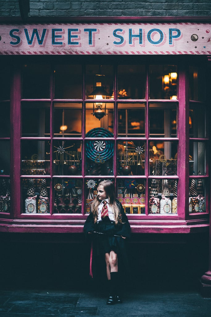 Emma in front of Sugarplum's Sweet Shop in Diagon Alley.