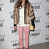 Olivia Palermo's pink print pants brought feminine flavour to her white top and fur coat at Topshop Unique.
