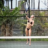 Hayden Panettiere hit a tennis ball with boyfriend, New York Jets wide receiver, Scotty McKnight, wearing a bikini while vacationing in Hawaii.