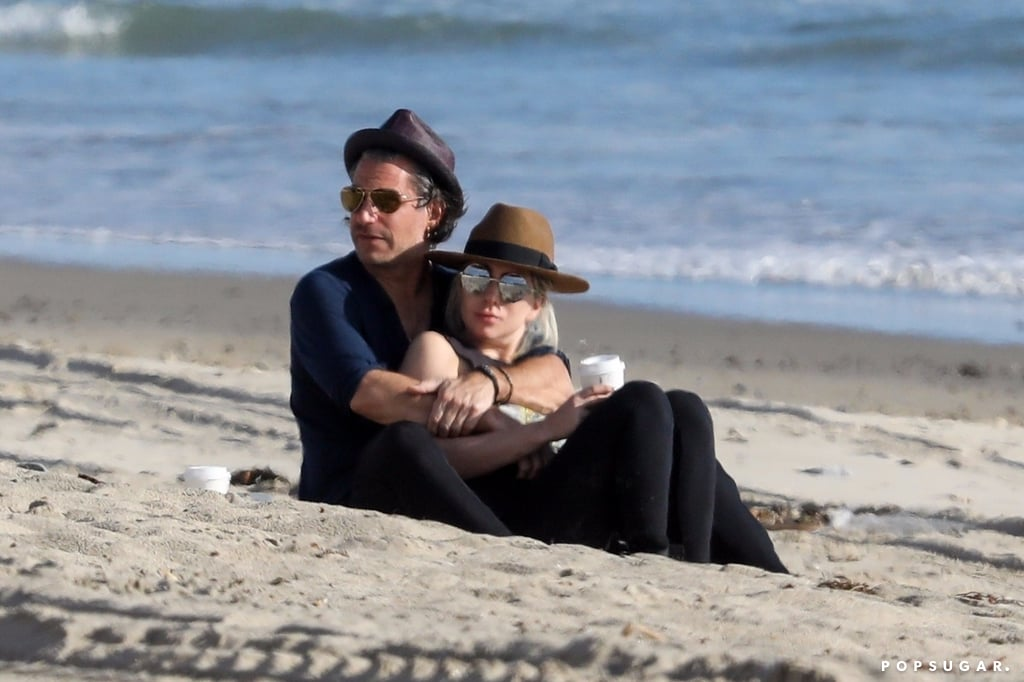 Lady Gaga and fiancé Christian Carino were in the mood for love during a PDA-filled beach day in Malibu, CA, on Sunday. The couple, who announced their engagement in November 2017, cuddled on the beach, drank coffee, and kissed in her vintage convertible — what an ideal Sunday afternoon, right? The Joanne songstress and her agent-turned-lover were later joined by a friend, whom they chatted with while people-watching and snuggling on the sand. Their outing almost immediately reminded us of a similar beach day between Gaga and her former flame Taylor Kinney, when they took a sweet stroll in Malibu the day after her Golden Globe win in 2016.      Related:                                                                                                           In Case You Were Wondering, Lady Gaga and Christian Carino Do Have a Bit of an Age Difference               Lady Gaga and Christian were first linked in Summer 2017, nearly a year after Gaga and Taylor ended their engagement; since then, we've gotten a glimpse of their chemistry via social media and on cute date nights. Gaga has been lying low since performing at the Grammys in January and canceling her remaining world tour dates in February due to complications from fibromyalgia and chronic pain. She is, however, set to begin a Las Vegas residency later this year. Luckily, she has Christian by her side for all the ups and downs.      Related:                                                                                                           18 Thirst-Inducing Lady Gaga Bikini Photos That Will Leave You Begging For a Glass of Water