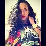 "Rihanna struck a pose in what she calls her ""new fav tee""."