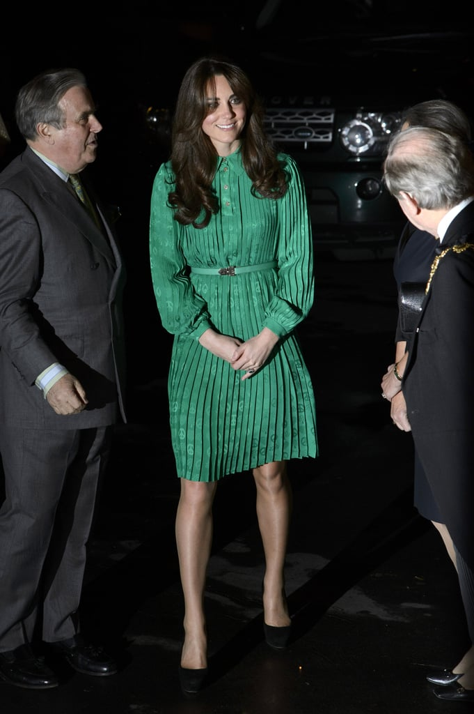 Kate Middleton wore a bright green Mulberry dress to attend a reception at London's Natural History Museum this evening. Kate also wore the peace-sign-adorned Mulberry dress to a private reception hosted by Queen Elizabeth II nearly a year ago to the day.  This evening, Kate attended the opening of the Treasures Cadogan Gallery. Kate was originally intended to go as the guest of Sir David Attenborough, a well-known broadcaster in the UK, but he was not able to attend. Instead, the Duchess of Cambridge got a tour of the new space from Michael Dixon, who is the director of the museum. Kate was treated to the viewing of many exciting objects, including a first edition of Charles Darwin's On the Origin of Species and dinosaur fossils.