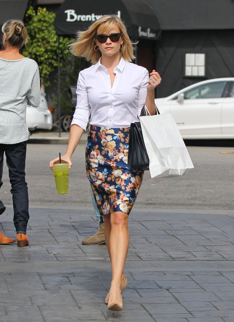 Witherspoon was all business in a crisp white blouse and blossoming J.Crew pencil skirt in LA's Brentwood neighborhood.