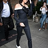 Kendall Was Seen Leaving Her Hotel Wearing an Off-the-Shoulder Pinstripe Jumpsuit by Bec + Bridge
