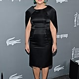Amy Poehler's black satin cape dress was anything but a basic LBD. Emerald-green drop earrings popped against her monochromatic ensemble.