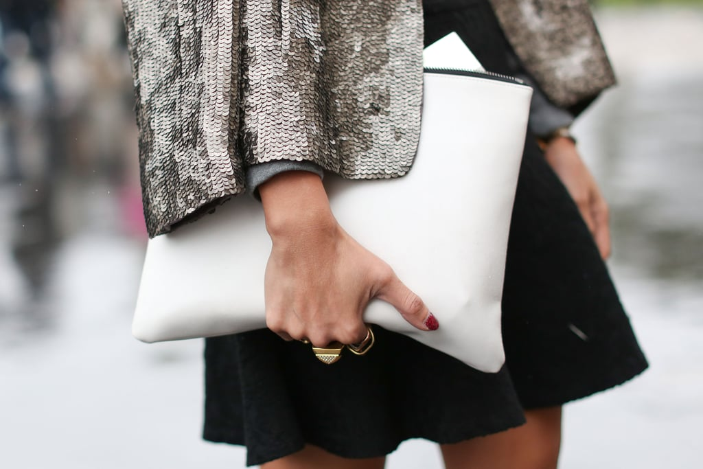We love the contrast of sequins and a sleek white clutch.