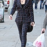 Gwen Stefani paired round sunglasses with a plaid suit.