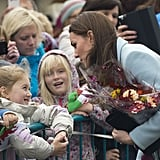 Kate greeted a group of kids outside the Pembroke Refinery in Wales in November 2014.