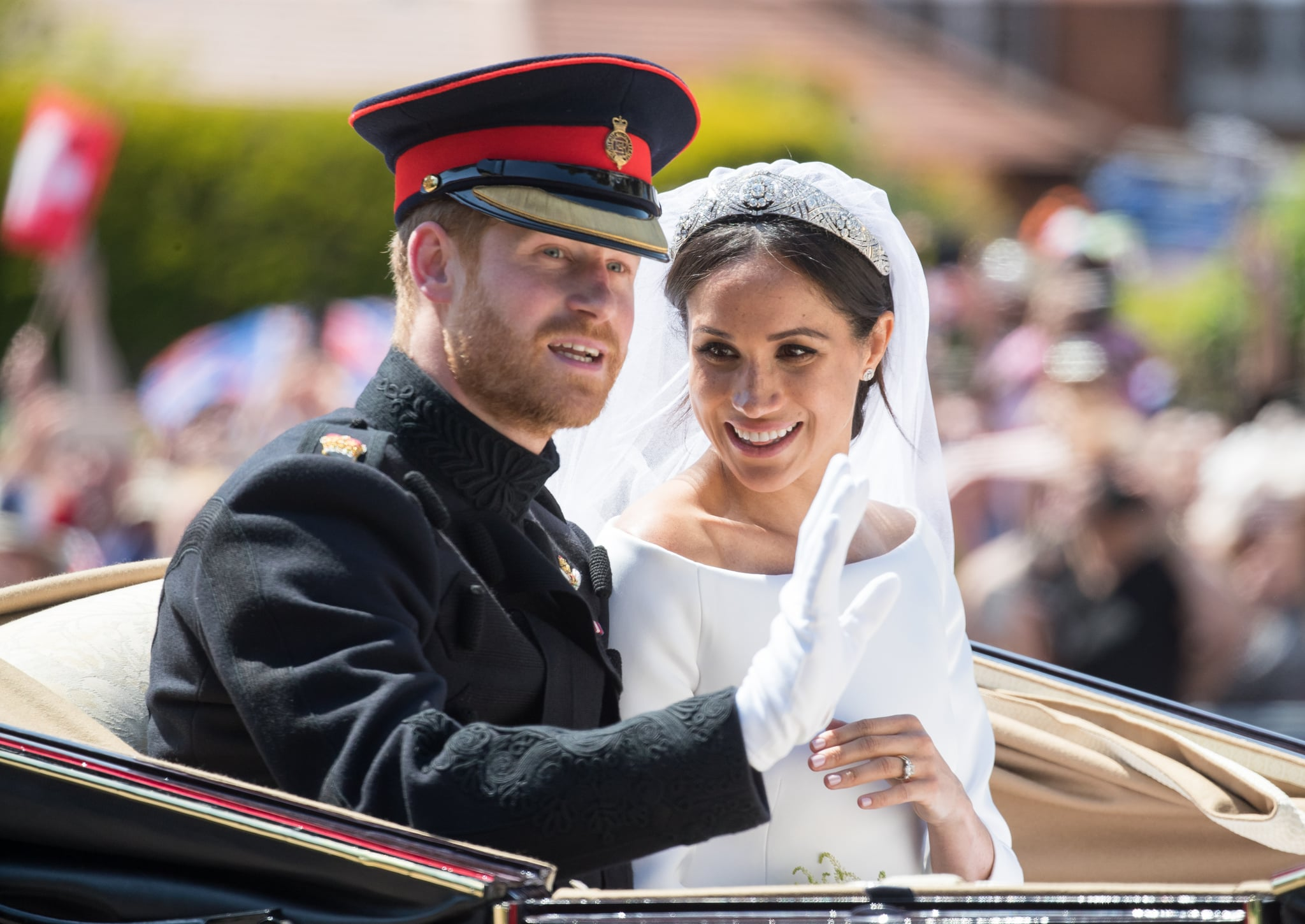 WINDSOR, ENGLAND - MAY 19:  Prince Harry, Duke of Sussex and Meghan, Duchess of Sussex ride by carriage following their wedding at St George's Chapel, Windsor Castle on May 19, 2018 in Windsor, England. Prince Henry Charles Albert David of Wales marries Ms. Meghan Markle in a service at St George's Chapel inside the grounds of Windsor Castle. Among the guests were 2200 members of the public, the royal family and Ms. Markle's Mother Doria Ragland.  (Photo by Pool/Samir Hussein/WireImage)