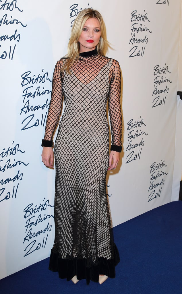 Kate Moss wore a fishnet gown to the British Fashion Awards.