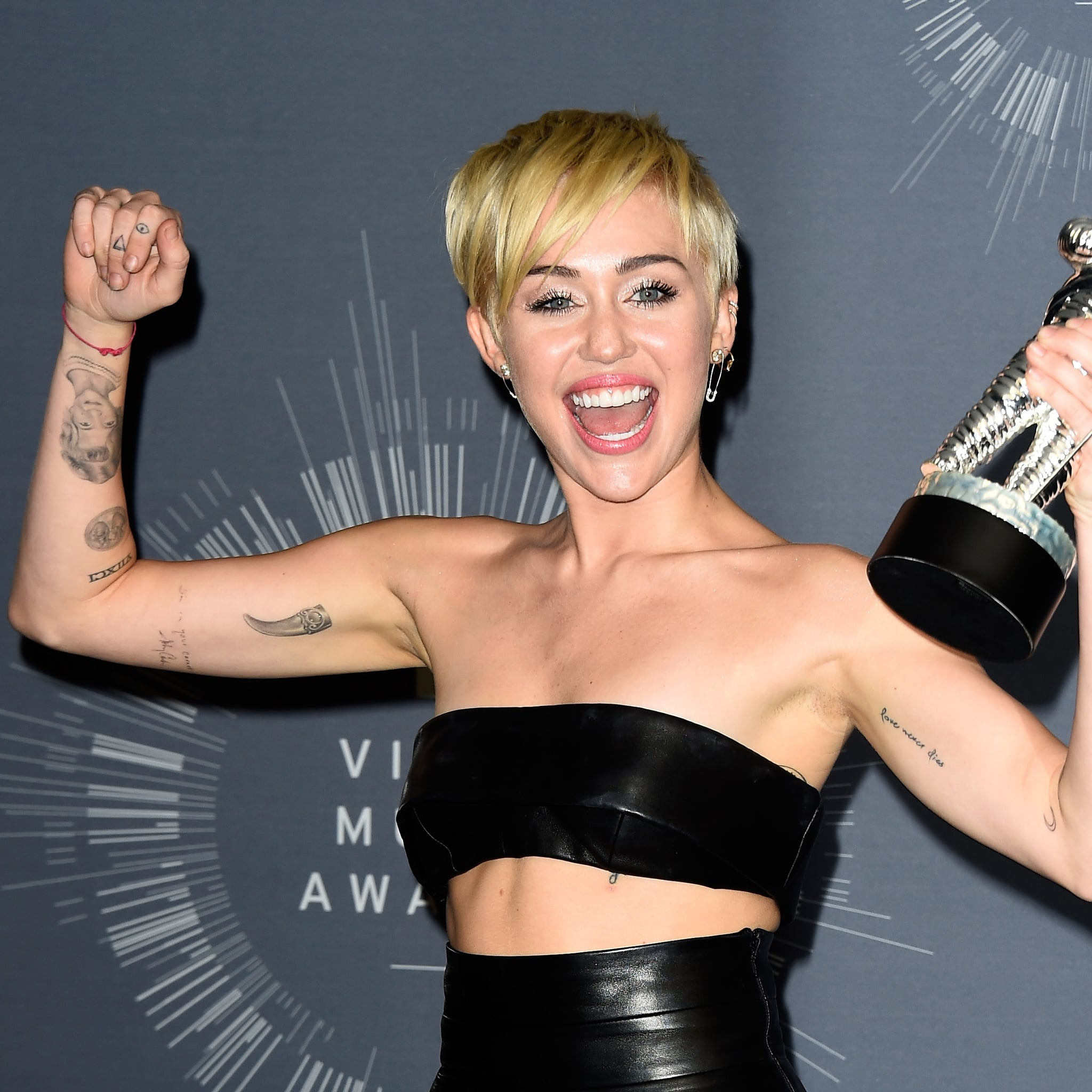 A Guide To Miley Cyrus S Most Meaningful Tattoos Popsugar Beauty