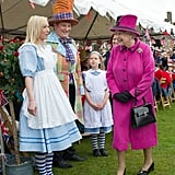 Queen Elizabeth II met Alice and the Mad Hatter as she attended a Mad Hatter's Tea Party at Sherborne Abbey.