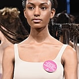 The CFDA distributed pink pins that are also spotted all over Fashion Week, on models and showgoers alike.