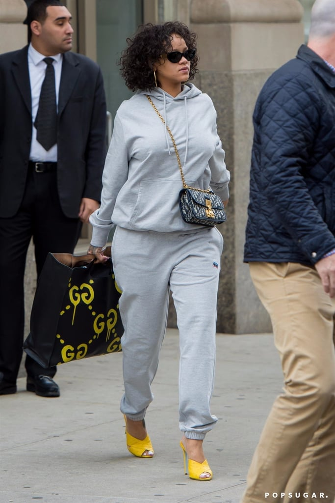 7bd841fdf70 Rihanna Carrying Gucci Graffiti Handbag