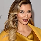 Kim Kardashian showed us how to match our jewel-toned outfits to our makeup. She wore a shimmering metallic liner around her eyes to play off the citrine hue of her clothes.