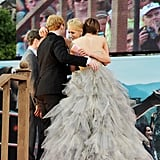 J.K. Rowling gave Rupert and Emma a big hug during the premiere.