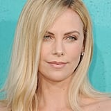 Charlize Theron wore her blond locks straight for the show.