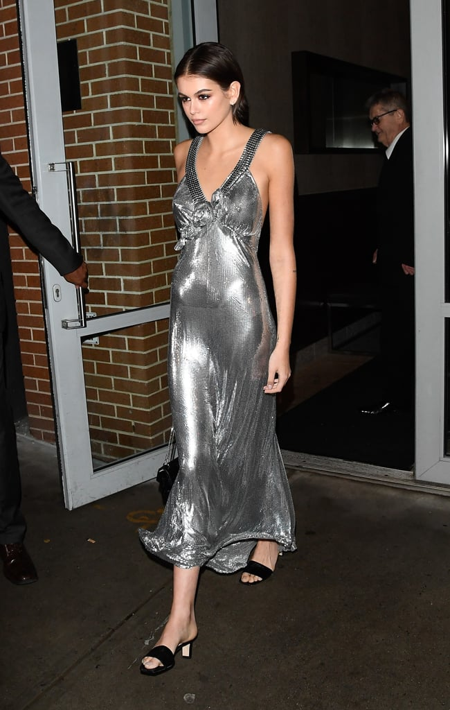 Kaia Gerber is starting New York Fashion Week strong. On Thursday night, the 18-year-old model hosted a party to celebrate the launch of her collection with Jimmy Choo, and it was most definitely a night to remember. Kaia rocked a gorgeous Paco Rabanne metal mesh v-neck dress and accessorized with Jimmy Choo heeled leather sandals from her fabulous collection. She also carried a crystal-embellished bag by the designer.  In January, Jimmy Choo announced the collaboration with Kaia, which launched earlier this month. It includes four shoes that absolutely speak to every fashion girl — there's a lace-up snake-print combat boot, suede Western boots, python block-heel sling-back pumps, and the leather block-heel sandals Kaia wore to the party. The capsule collection ranges from $595-$1,195, and 15 percent of all sales from the collection will be donated to St. Jude Children's Research Hospital.  To celebrate the launch of her collection, Kaia dressed to the nines with the flower-embellished slinky gown and gave us strong disco vibes. See photos of her launch party look ahead.      Related:                                                                                                           The Supermodels Provided Us With Serious Street Style This Fashion Month