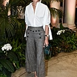 For Carolina Herrera's show, Olivia suited up in her most sophisticated look with a white blouse and cropped trousers, and another Salar Milano bag in tow.