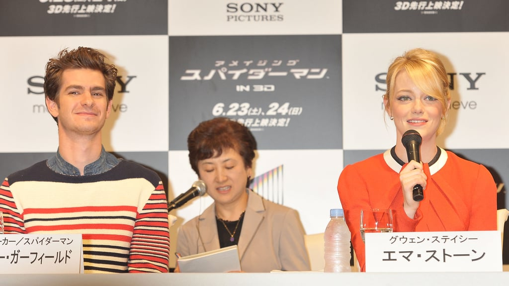 Andrew Garfield smiled while Emma Stone spoke at the press conference for The Amazing Spider-Man in Japan.