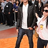 Zac Efron was all smiles in black leather and skinny jeans.