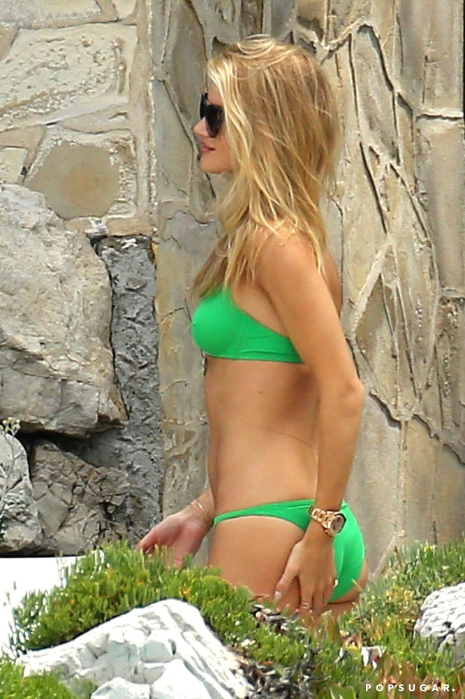 Rosie Huntington-Whiteley lounged in a green bikini.