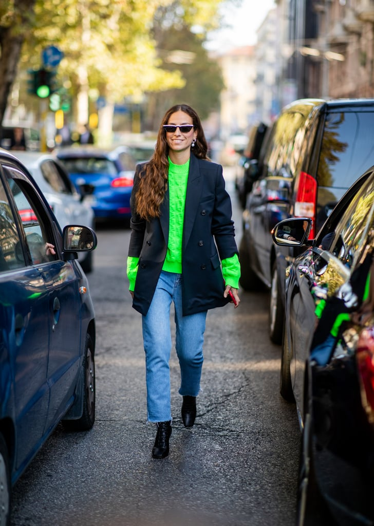 Mute an Electric Neon Jumper With a Structured Blazer Pulled Up at the Sleeves