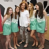 Diane von Furstenberg poses with her design-clad models.