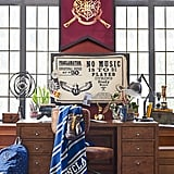 Hogwarts House Throw Blanket ($69) and Hogwarts Crest Scroll ($49)