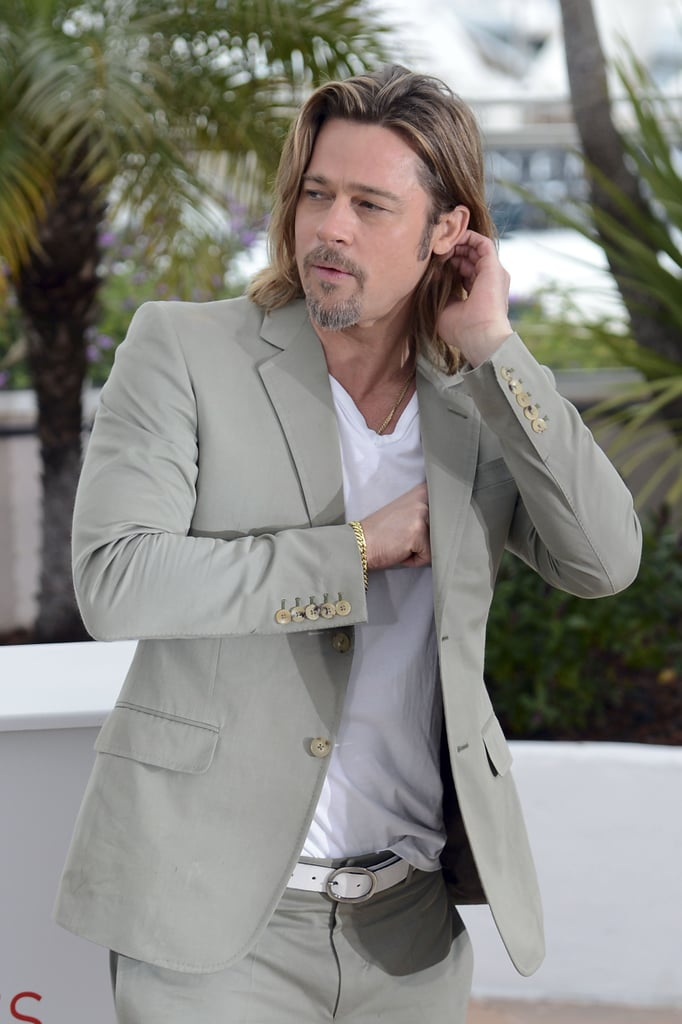 Brad tucked his hair behind his ear while at a Killing Them Softly photocall during the Cannes Film Festival in May 2012.