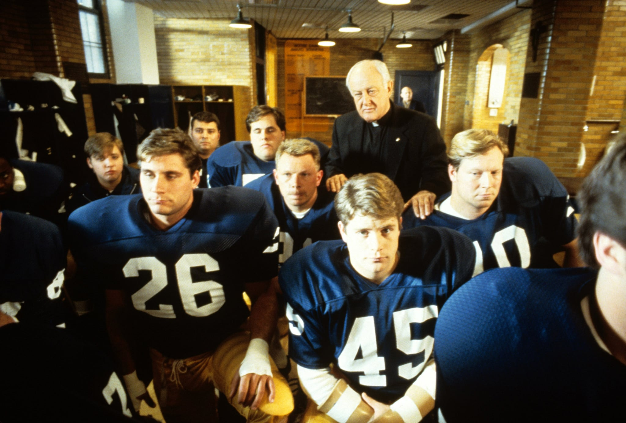 RUDY, Sean Astin (centre right), Father James Riehle (back), 1993, TriStar Pictures/courtesy Everett Collection