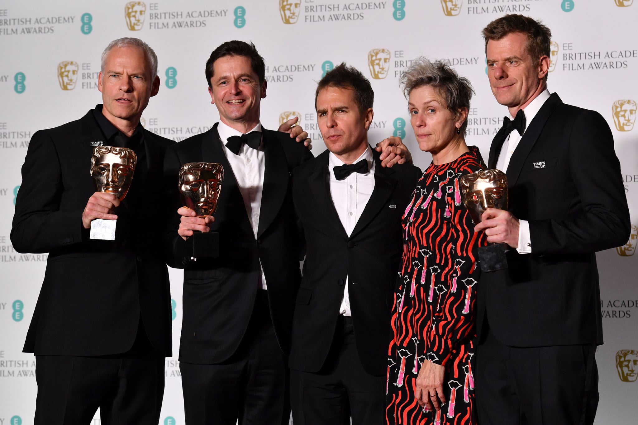 TOPSHOT - British-Irish filmmaker Martin McDonagh (L), producer Peter Czernin (2L), supporting actor award winner US actor Sam Rockwell, and British producer Graham Broadbent (R) pose with leading actress award winner US actress Frances McDormand (2R) after receiving the award for Best Film for 'Three Billboards Outside Ebbing Missouri' at the BAFTA British Academy Film Awards at the Royal Albert Hall in London on February 18, 2018. (Photo by Ben STANSALL / AFP)        (Photo credit should read BEN STANSALL/AFP/Getty Images)