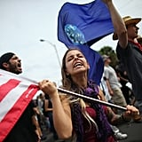 A female protester waved an American flag.