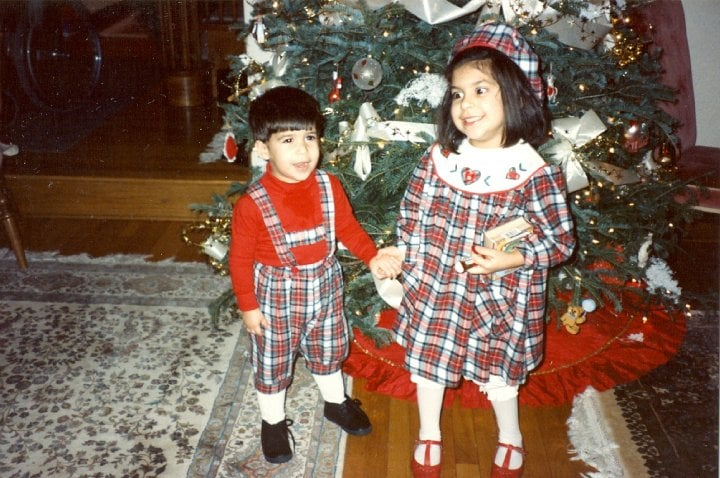 """My mom was really into dressing me and my sister (who is pictured as my partner in plaid) in matching outfits when we were both too young to dress ourselves. But I see what she was getting at: my plaid capri-length overalls (lederhosen?), thick red turtleneck, white socks, and black shoes were the perfect complements to our holiday decor. After all, when was the last time that you could boast not only matching your sister but also the Christmas tree skirt?"" — Robert Khederian, editorial assistant, POPSUGAR Fashion"