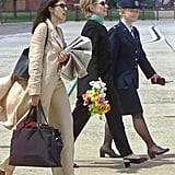 Huma Knows That Breezy Linen Suits and Block Heels Are Best For Traveling