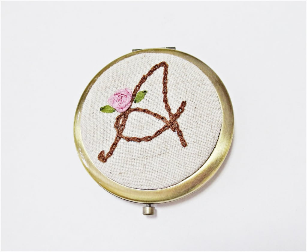 A cute compact gets an instant upgrade with a kitschy, embroidered mirror ($30).