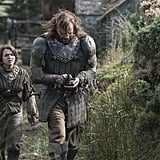Maisie Williams as Arya Stark and Rory McCann as The Hound.