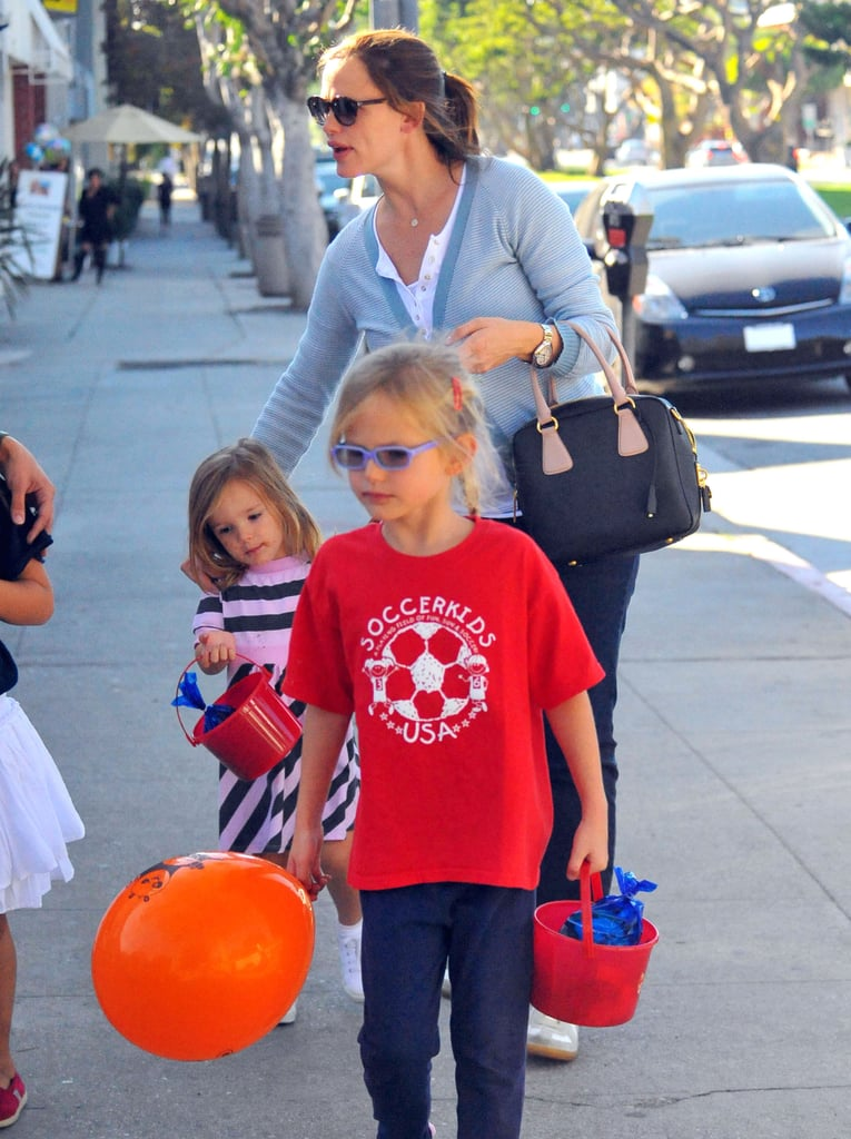 Jennifer Garner takes Violet and Seraphina out before Halloween.