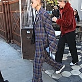 Hailey looked awesome in this checked suit and a scrunchie while out in LA in December.