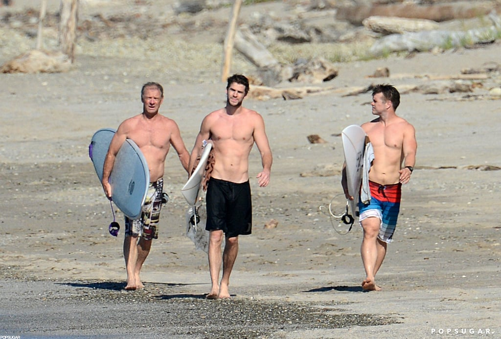 Liam Hemsworth hit the beach in Costa Rica with friends.