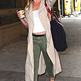 While out in NYC, Jennifer stuck to neutrals. She wore a white top, army green pants, and a beige trench coat. Flat two-toned sandals topped off her look.