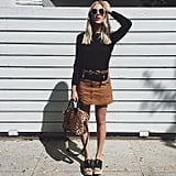 A Suede Skirt, a Black Top, a Belt, and Platform Sandals