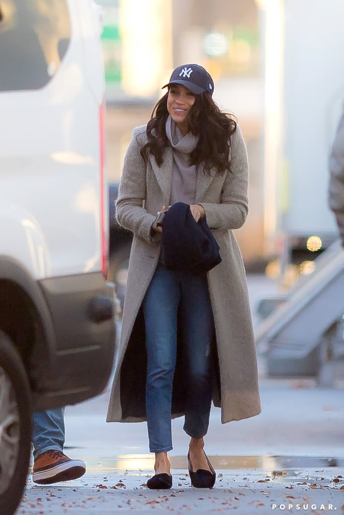 "Meghan Markle appeared to be in good spirits while walking around the set of Suits on Saturday afternoon. The actress, who is currently dating Prince Harry, could not hide her smile as she met with crew members and made her way to her car. Meghan bundled up for the chilly Toronto weather in a trench coat, navy scarf, and a baseball cap. Her latest appearance comes just one week after it was reported that Meghan visited Harry in London; the actress was spotted grocery shopping near Kensington Palace, and sources close to her say she's ""head over heels"" for Harry and is ""doing everything she can to make the relationship work."" We wonder if she'll be visiting Harry during his Caribbean tour too!       Related:                                                                                                           Everything There Is to Know About Prince Harry and Meghan Markle's Royal Relationship"